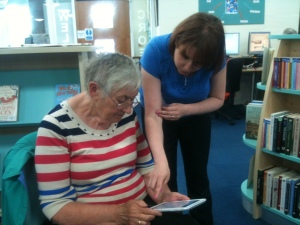 Bethan shows Margaret how to download free books on her e-reader