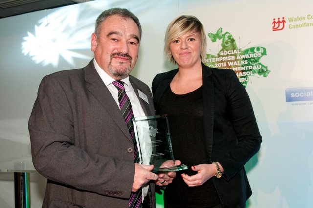 Cris Tomos receiving his Social Enterprise Champion Wales  award from former winner Kelly Davies of Vi-Ability.