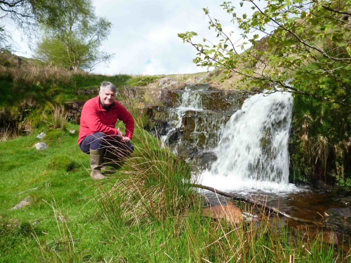 Llangattock Green Valleys director Andrew Fryer at the Nant yr Hafod stream, one of four micro hydro schemes the group is planning to build as part of its second co-operative share offer.